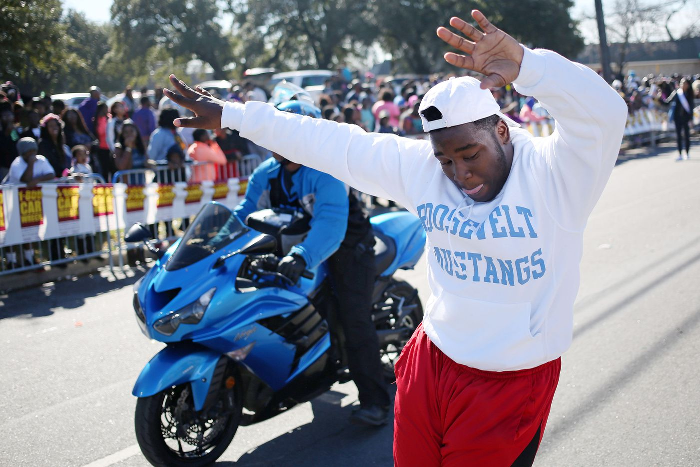 A Franklin D. Roosevelt High School student dances during the parade.