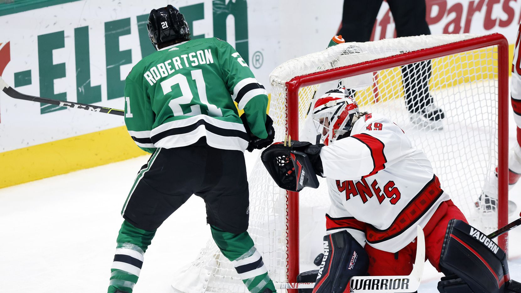 Dallas Stars left wing Jason Robertson (21) scores on Carolina Hurricanes goaltender Alex Nedeljkovic (39) during the second period at the American Airlines Center in Dallas, Tuesday, April 27, 2021.