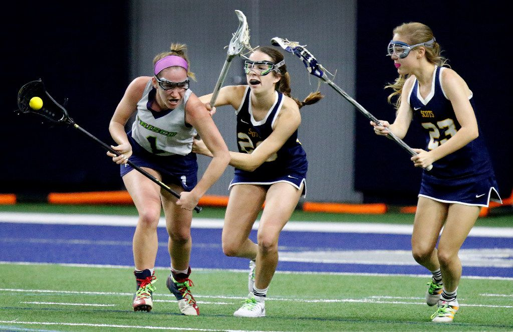 Frisco's Madison Altieri (1) charges the goal in an attempt to make a play as Highland Park defenders Sloane Kipp (20) and Mia London (23) give chase during the second half as Highland Park played the Frisco Fury as part of the Patriot Cup lacrosse tournament at The Ford Center at The Star in Frisco on Saturday, February 18, 2017. Altieri scored Frisco's only goal. (Stewart F. House/Special Contributor)