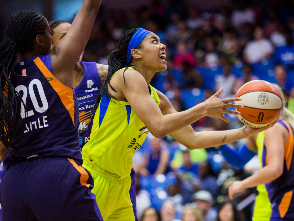 Dallas Wings guard Allisha Gray (15) looks for a shot during the first quarter of a WNBA game between the Dallas Wings and the Phoenix Mercury on Saturday, July 20, 2019 at UTA's College Park Center in Arlington, Texas. (Ashley Landis/The Dallas Morning News)