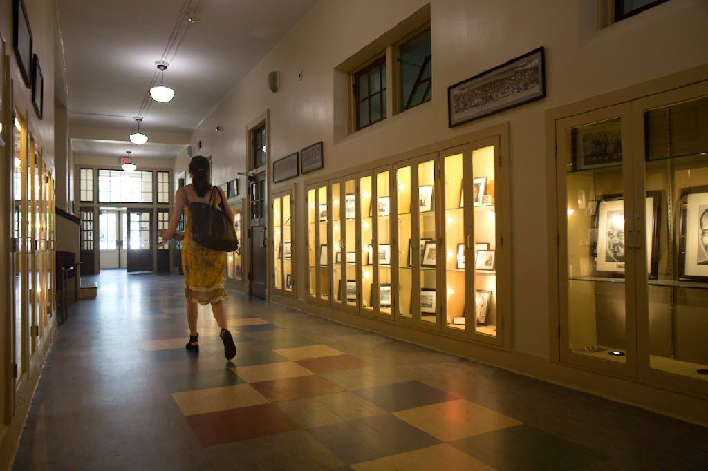 A woman walks down a hallway at Booker T. Washington High School for the Performing and Visual Arts in Dallas.