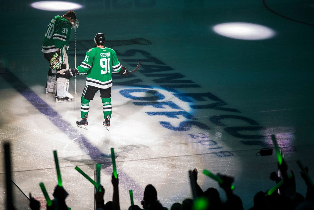 Dallas Stars goaltender Ben Bishop (30) and Dallas Stars center Tyler Seguin (91) take a moment before Game 3 of a playoff series between the Dallas Stars and the Nashville Predators on Monday, April 15, 2019 at American Airlines Center in Dallas.