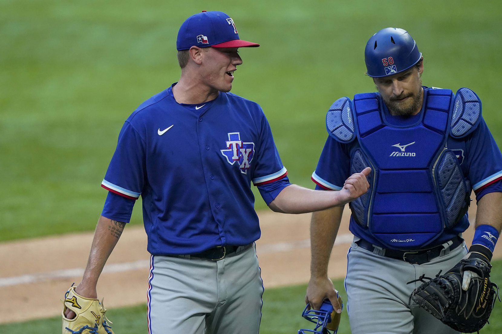 Kolby Allard talks with catcher Tim Federowicz after pitchring in an intrasquad game during Texas Rangers Summer Camp at Globe Life Field on Friday, July 17, 2020.