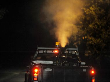 A truck is pictured spraying for mosquitoes in Dallas in an effort to stop the spread of West Nile virus. Southlake will spray for two nights this week following another positive West Nile sample.