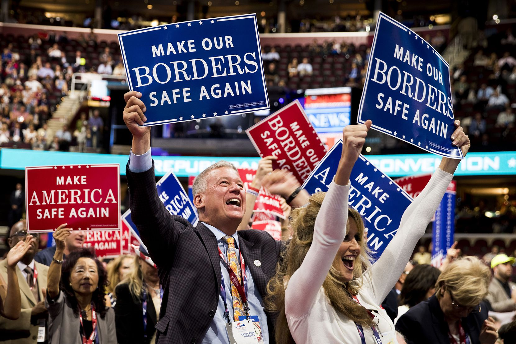 California delegates cheer a speech by U.S. Rep. Michael McCaul of Texas during the second session of the Republican National Convention.