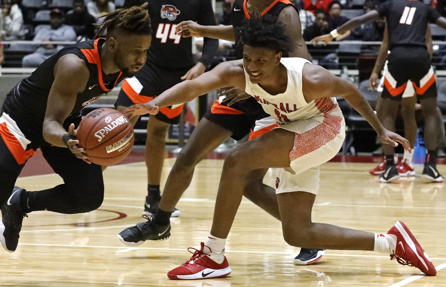Lancaster High School guard Mike Miles (1) steals the ball from Kimball High School forward Cory Reynolds (11) during the second half as Kimball High School played Lancaster High School for the Class 5A Region II championship at the Curtis Colwell Center in Garland on Saturday, March 7, 2020.