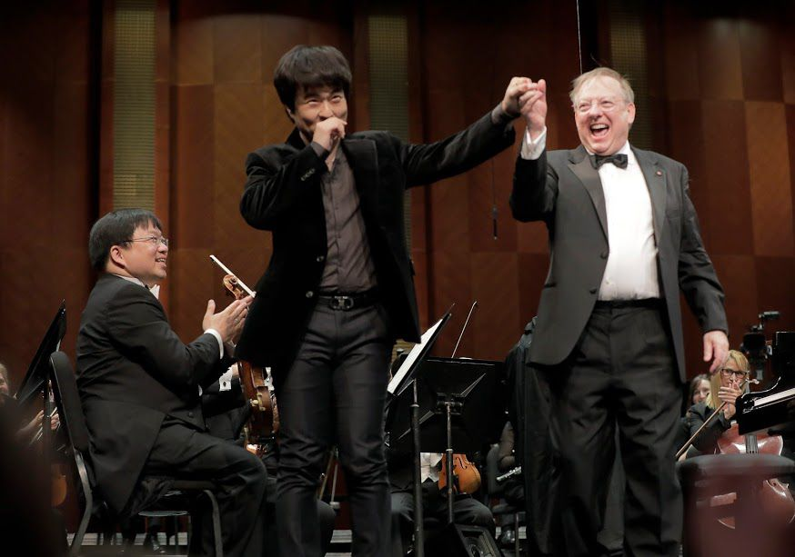 Pianist Dasol Kim took a bow with conductor Nicholas McGegan after performing with the Fort Worth Symphony Orchestra in the Semifinal Round of the Van Cliburn International Piano Competition on Saturday. (Ralph Lauer/Van Cliburn)