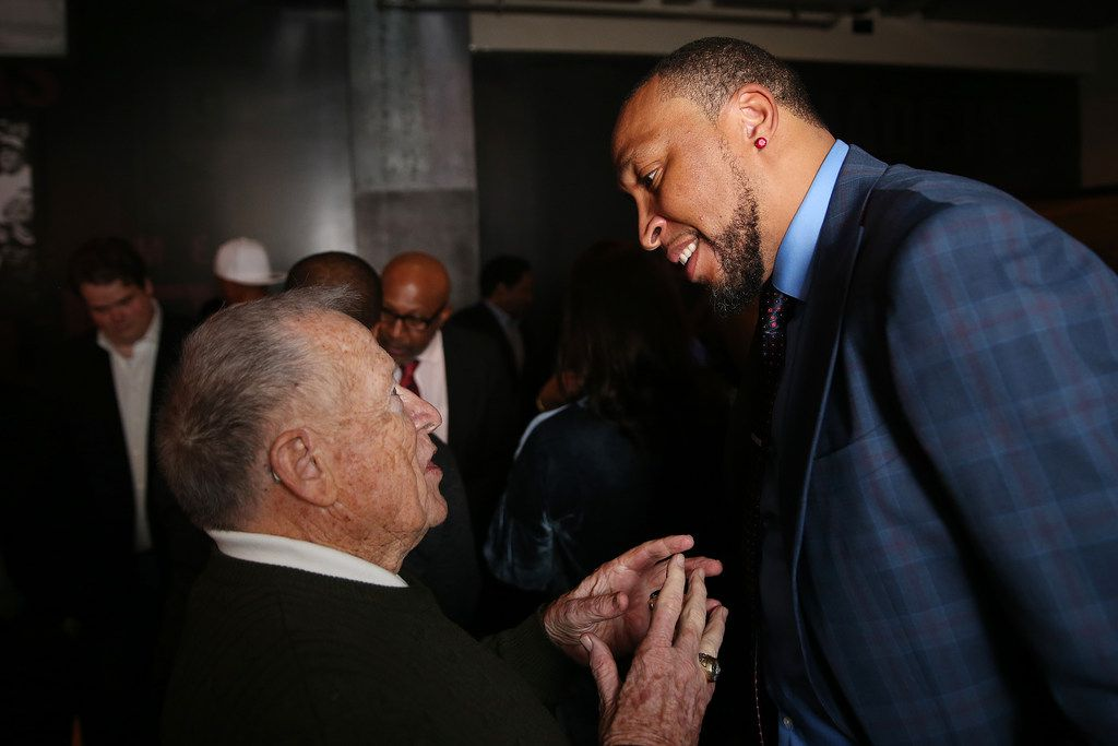 Former Dallas Mavericks head coach Dick Motta speaks with former basketball player Shawn Marion during an after party following the jersey retirement ceremony for former Dallas Mavericks player Derek Harper after a National Basketball League game between the New York Knicks and Dallas Mavericks at the American Airlines Center in Dallas Sunday January 7, 2018. Former Dallas Mavericks player Derek Harper will have his number 12 jersey retired during a halftime ceremony. (Andy Jacobsohn/The Dallas Morning News)