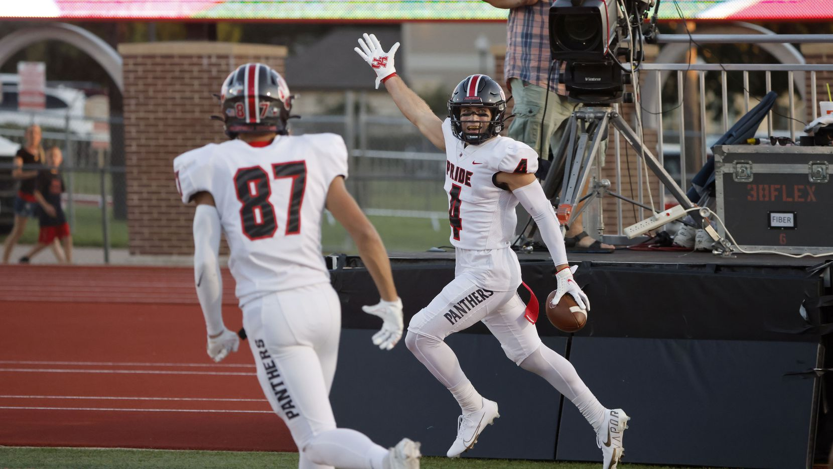 Colleyville Heritage receiver Hogan Wasson (4) celebrates his first quarter touchdown against Grapevine with Braden Blueitt (87)during their high school football game in Grapevine, Texas on Aug. 27, 2021.