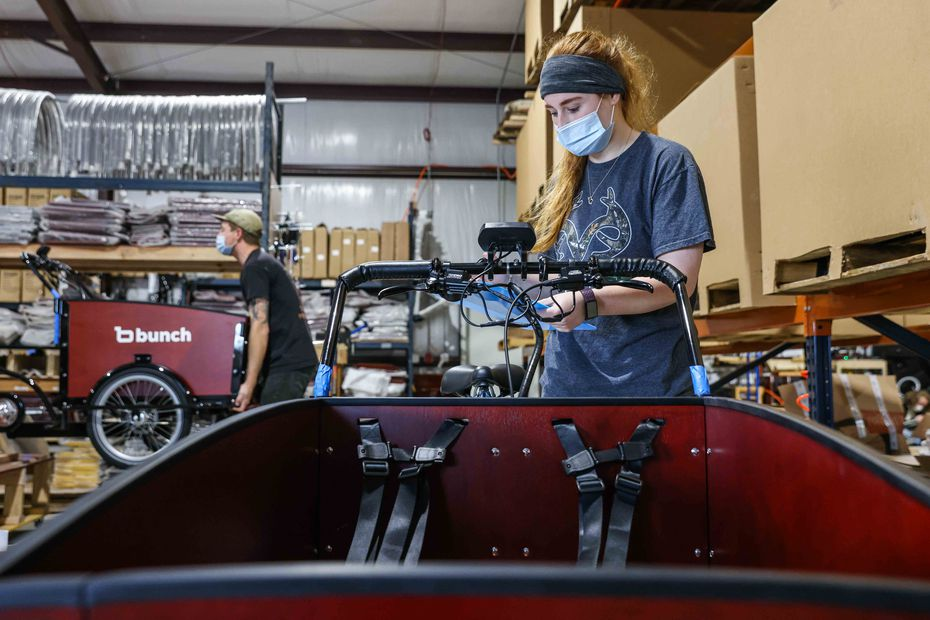 Lidia Banyai checks the quality of bikes after being assembled at Bunch Bikes in Denton on Wednesday, March 24, 2021. (Lola Gomez/The Dallas Morning News)