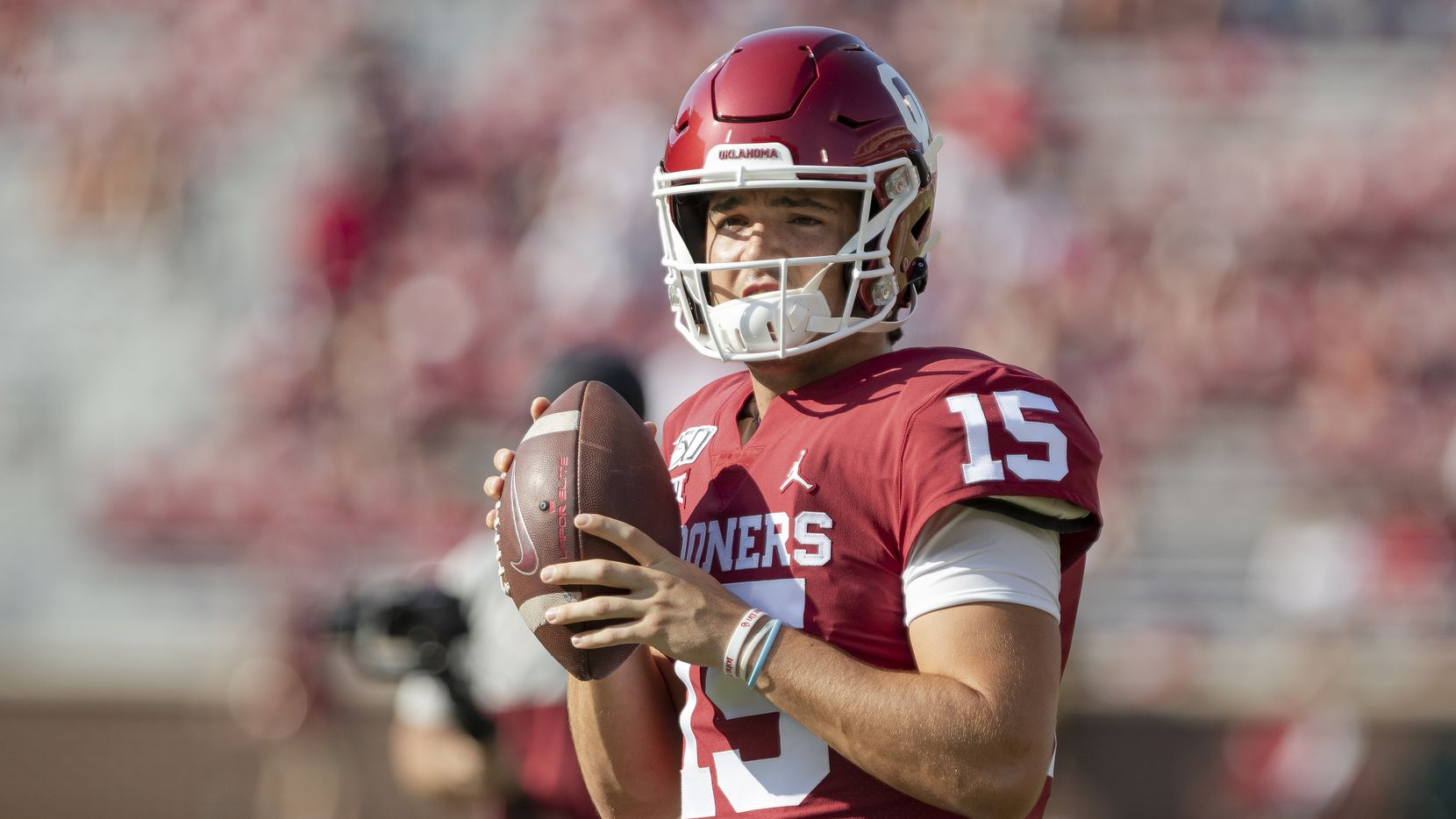 FILE - Oklahoma quarterback Tanner Mordecai (15) is pictured before the start of a game against South Dakota on Sept. 7, 2019, at Gaylord Family-Oklahoma Memorial Stadium in Norman, Okla.