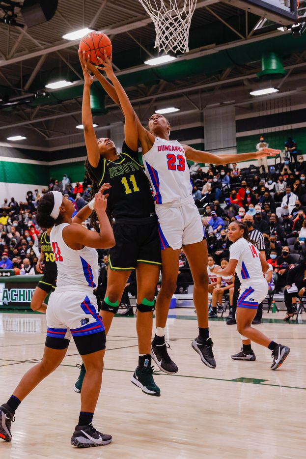 DeSoto's Tionna Herron (11) attempts to shoot against Duncanville's Kiersten Johnson (23) during the first half of a UIL girls basketball Class 6A Region II in Waxahachie on Tuesday, March 2, 2021. (Juan Figueroa/ The Dallas Morning News)