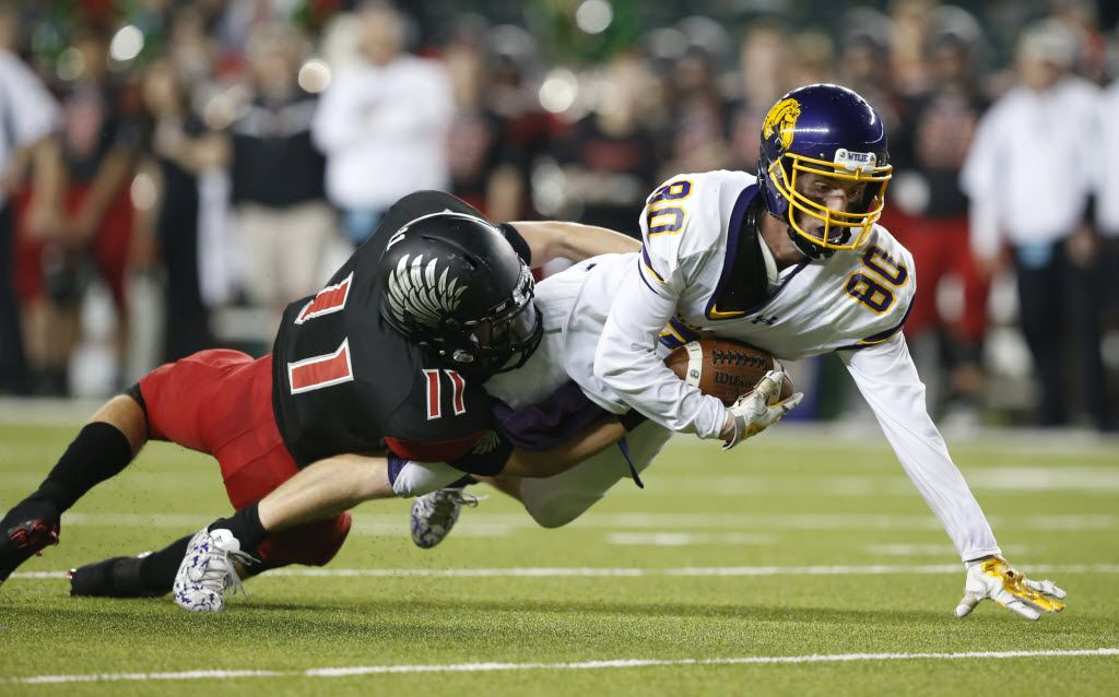 Abilene Wylie Bulldogs Jaxson Money (80) is tackled by Argyle Eagles John Tarwater (11) during the first half of a 4A High School State Semifinals football game between Argyle Eagles Vs Abilene Wylie Bulldogs on Friday, December 11, 2015, in Waco, Texas. DRC Jose Yau