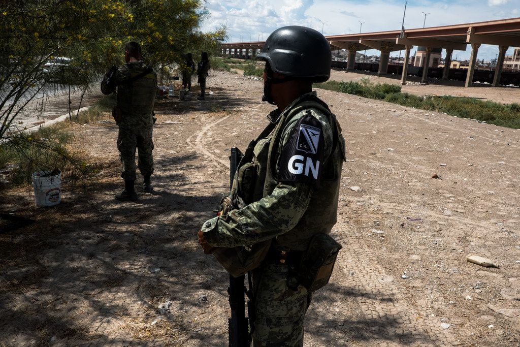 Members of the Mexican National Guard patrol an area along the Rio Grande in Juarez on Thursday, Aug. 1, 2019. Under pressure from the Trump administration, the Mexican government has deployed thousands of guardsmen to stop migrants from entering the U.S.