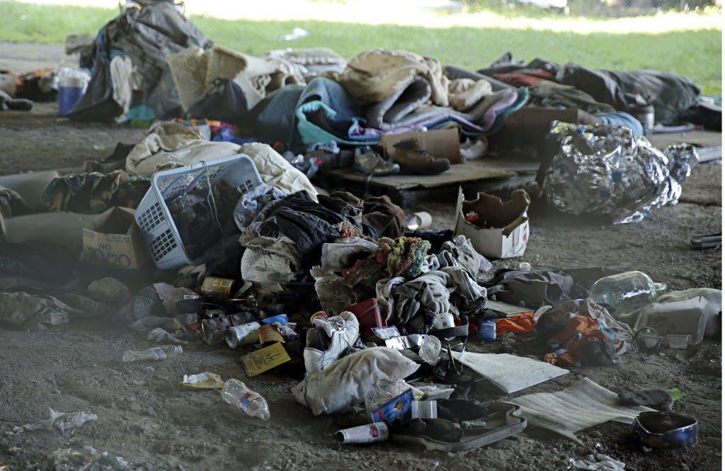 Personal belongings and trash sit in piles in Tent City Tuesday, May 3, 2016 in Dallas. The final two sections of the contentious homeless encampment where closed Tuesday morning, sending the remaining residents scrambling for shelter.