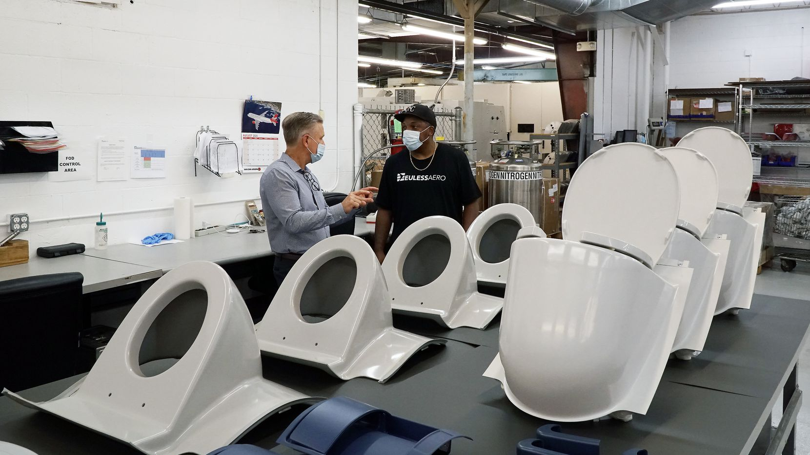 Aereos partner David Baker (left) discusses airplane replacement parts with floor manager Rajshaad Taylor at the company's Euless location.