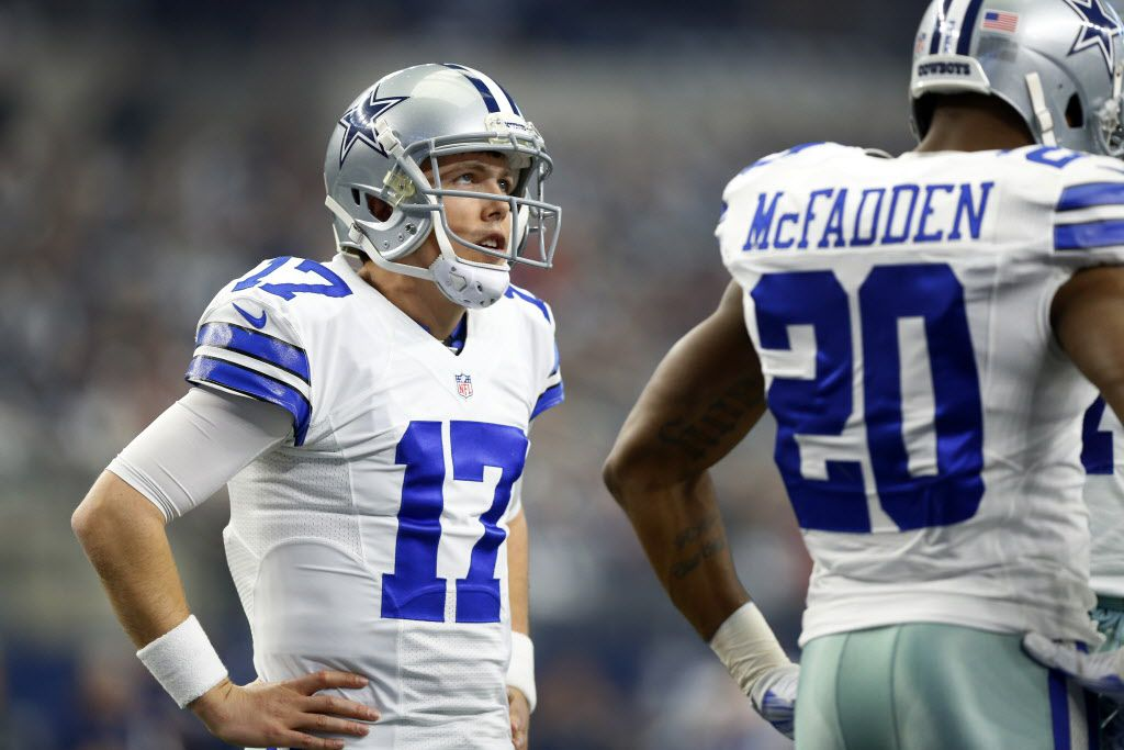 Dallas Cowboys quarterback Kellen Moore (17) waits in the huddle for a timeout to end against the Washington Redskins at AT&T Stadium in Arlington, Texas, Sunday, January 3, 2016. (Tom Fox/The Dallas Morning News)