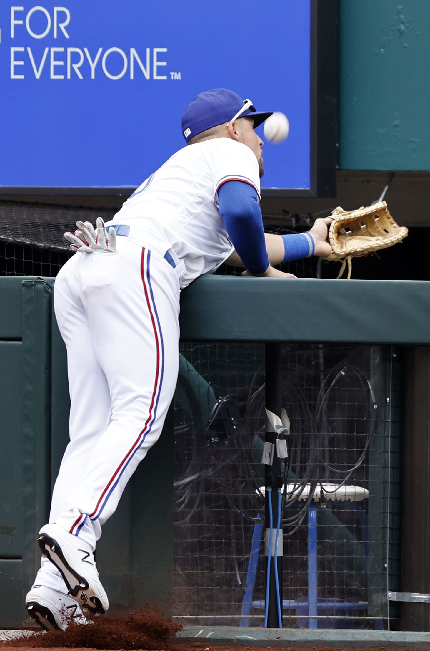 Texas Rangers first baseman Nate Lowe (30) attempts to catch a Toronto Blue Jays foul ball during ninth inning at Globe Life Field in Arlington, Monday, April 5, 2021. The Texas Rangers were facing the Toronto Blue Jays in their home opener. The Rangers lost, 6-4. (Tom Fox/The Dallas Morning News)