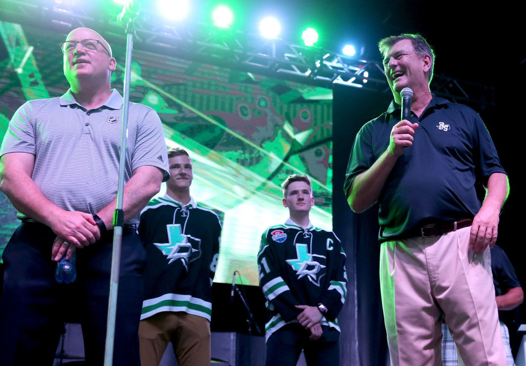 Bill Daly (left), National Hockey League Deputy Commissioner, and Dallas Mayor Mike Rawlings announce that Dallas will host the 2018 NHL Draft at the American Airlines Center, during a Reunion Lawn Party monthly event on Saturday night, July 29, 2017 in Dallas. Behind them are draft-eligible players Jace Foskey (2nd from left) and Ryan O'Reilly. (Allison Slomowitz/Special Contributor to The Dallas Morning News)