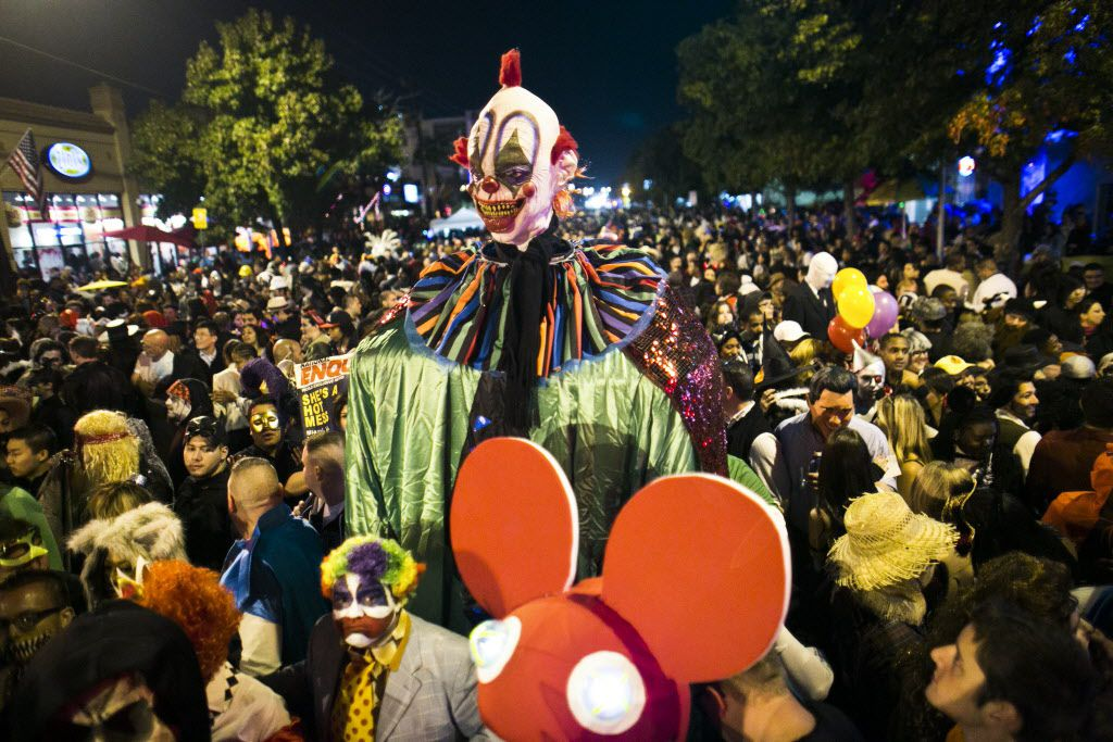 An enormous clown costume towers over the massive crowd of costumed party goers for the 2012 Oak Lawn Halloween Street Party in Dallas. The celebration has been canceled for 2020. (Christian Randolph/The Dallas Morning News)