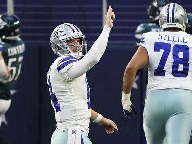 Dallas Cowboys quarterback Andy Dalton (14) celebrates after throwing a touchdown pass to wide receiver Michael Gallup during the second quarter of an NFL football game against the Philadelphia Eagles at AT&T Stadium on Sunday, Dec. 27, 2020, in Arlington.