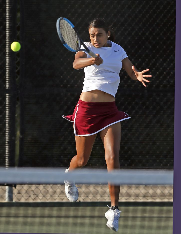 Frisco Heritage's Sriya Leesha Gourammagari returns a serve in the 5A girls singles match at the UIL State Tennis finals at Northside Tennis on Friday, May 21, 2021.