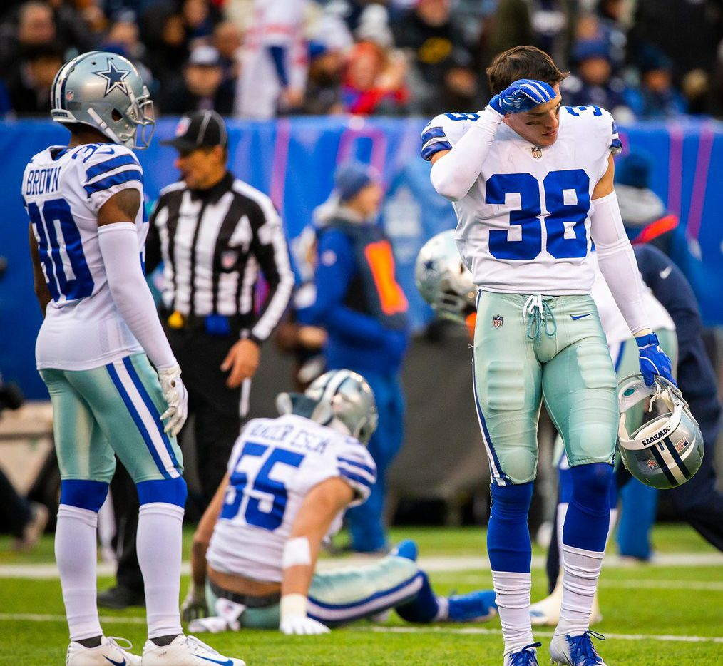 Dallas Cowboys strong safety Jeff Heath (38) turns away as outside linebacker Leighton Vander Esch (55) receives attention after being injured during the second half of an NFL football game at MetLife Stadium on Sunday, Dec. 30, 2018, in East Rutherford, New Jersey. (Smiley N. Pool/The Dallas Morning News)