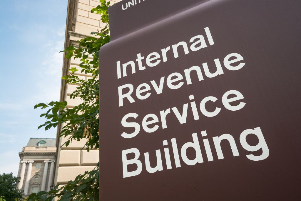The Internal Revenue Service building in Washington, D.C. The IRS is responsible for collecting taxes in the United States as well as the administration of the Internal Revenue Code and has 89,500 employees. Annually, it collects approximately $2.4 trillion in taxes.