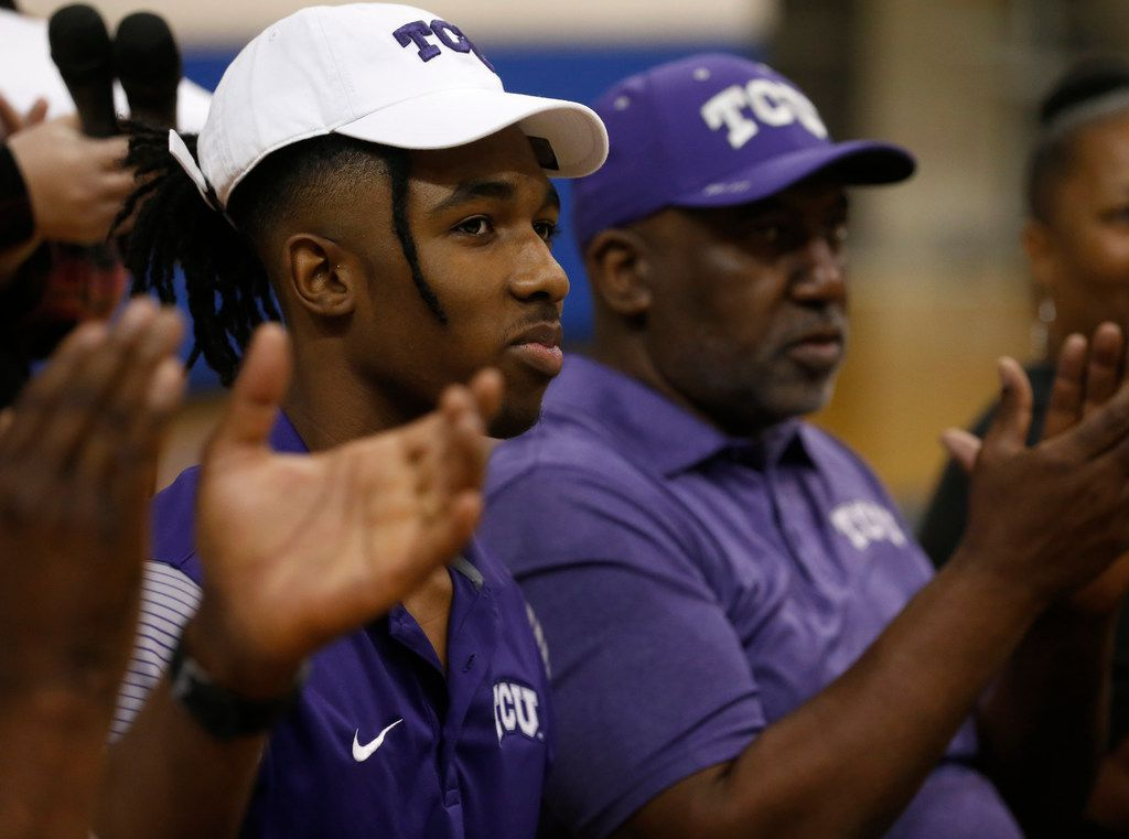 Midlothian basketball player Kaden Archie reacts after signing a national letter of intent with TCU at Midlothian High School in Midlothian, Texas on Wednesday, Nov. 8, 2017. (Rose Baca/The Dallas Morning News)