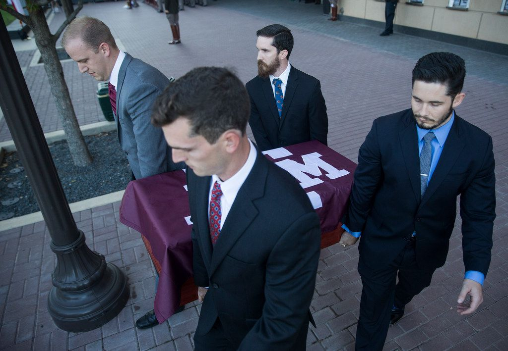 Former handlers of Reveille VIII Daylon Most (left to right), Parker Smith, Ben Coffman and Cody Guffey serve as pallbearers during a funeral service for former Texas A&M mascot Reveille VIII on Thursday, August 30, 2018 at The Zone Plaza of Kyle Field in College Station, Texas. Reveille VIII, who passed away in June at the age of 12, represented Texas A&M from August 2008 until her retirement in May 2015. (Ryan Michalesko/The Dallas Morning News)