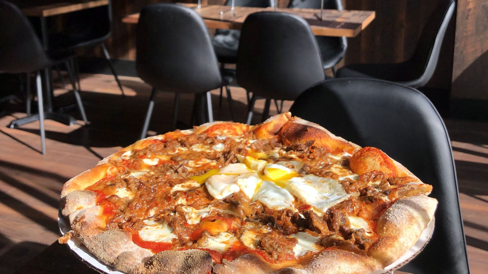 Flattery is a pizza joint in Dallas that opened in December 2019. Here's the Texan pizza topped with beef, mozzarella and a fried egg.