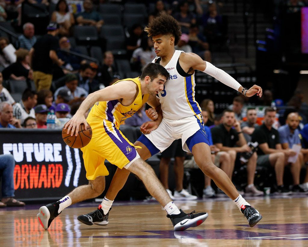 Golden State Warriors guard Jordan Poole, right, blocks the drive of Los Angeles Lakers guard Dakota Mathias during the second half of an NBA basketball summer league game in Sacramento, Calif., Tuesday, July 2, 2019. (AP Photo/Rich Pedroncelli)