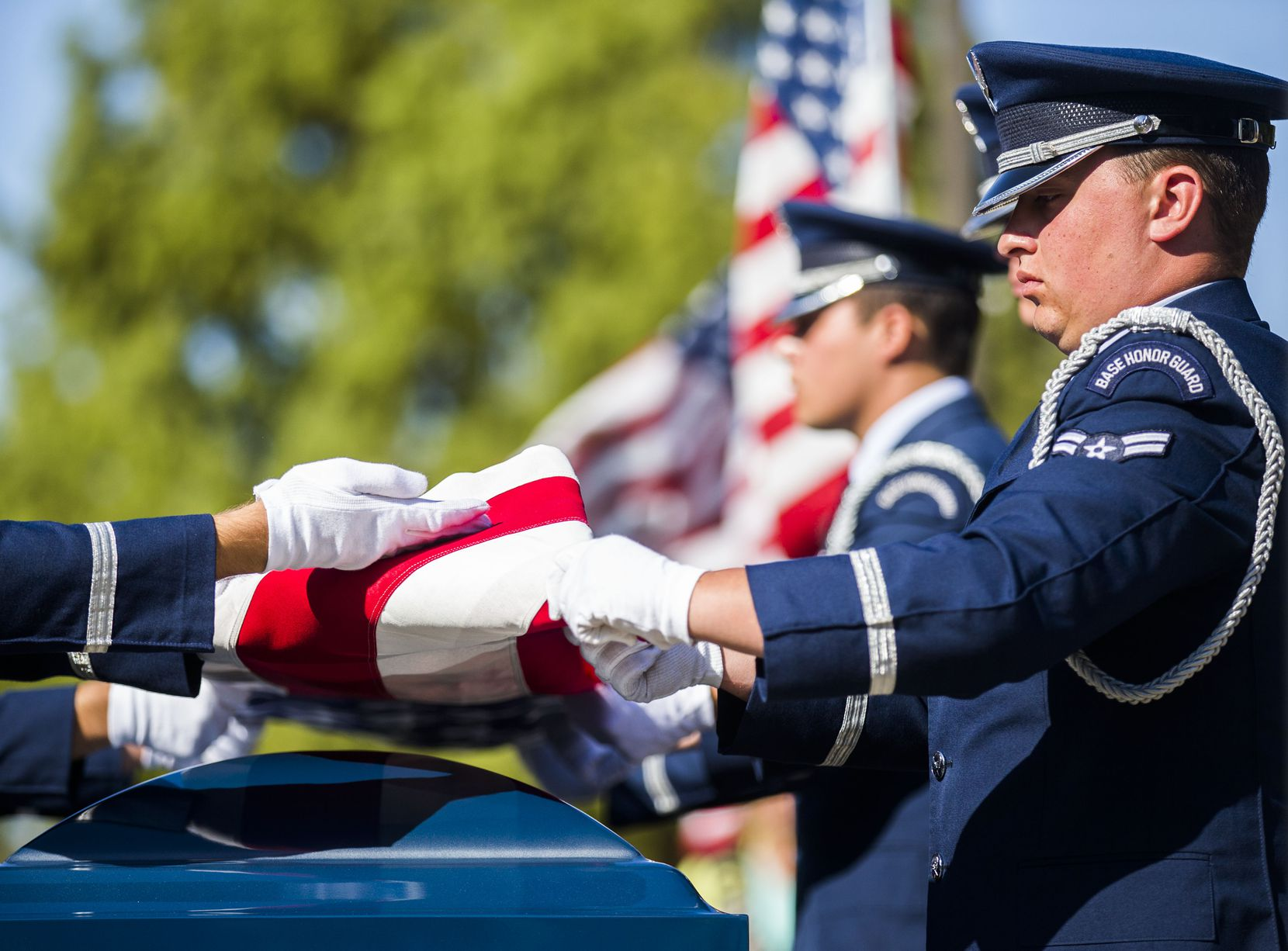A military honor guard folds an American flag over the remains of retired Army Air Corps 1st Lieutenant Calvin Spann during funeral services  on Saturday, September 12, 2015 at Covenant Church in Carrollton, Texas.  Spann was an original Tuskegee Airman and fighter pilot with the 100th Fighter Squadron of the 332nd Fighter Group.  He served during World War II, when he flew 26 combat missions. (Ashley Landis/The Dallas Morning News)