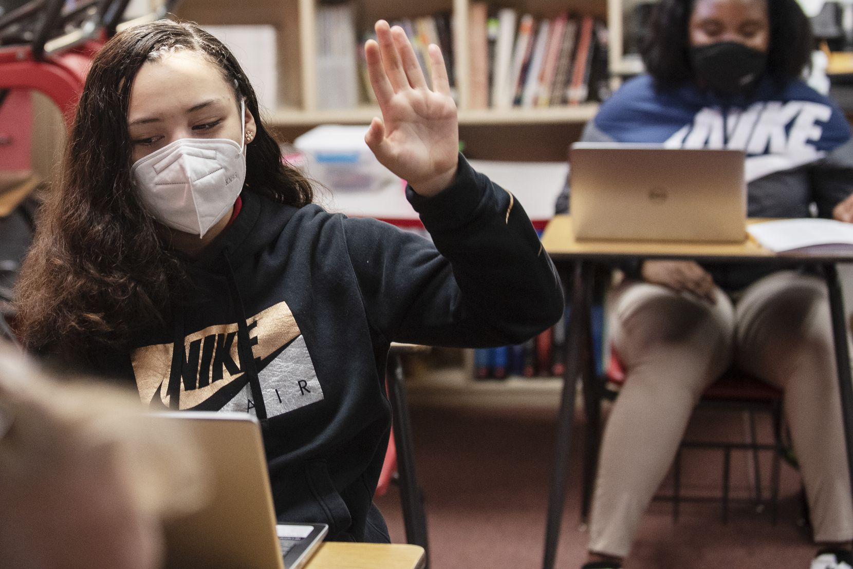 Eighth grader Yarettzi Chavez raised her hand to answer a question as her social studies class discussed the election Wednesday at Permenter Middle School in Cedar Hill.