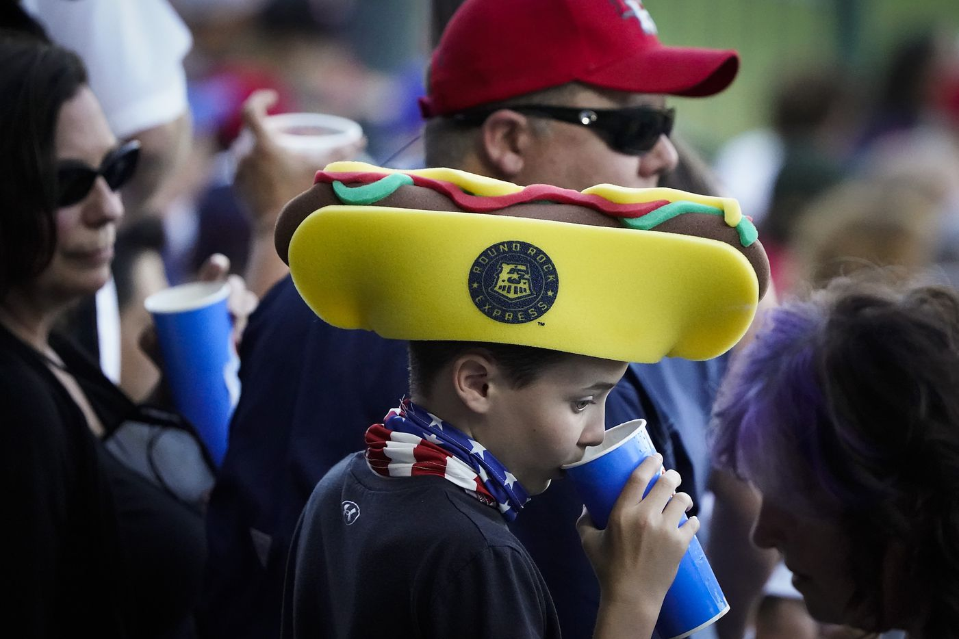 A young fan wears a foam hotdog hat during the first inning of the Round Rock Express season opener against the Oklahoma City Dodgers at Dell Diamond on Thursday, May 6, 2021, in Round Rock, Texas.