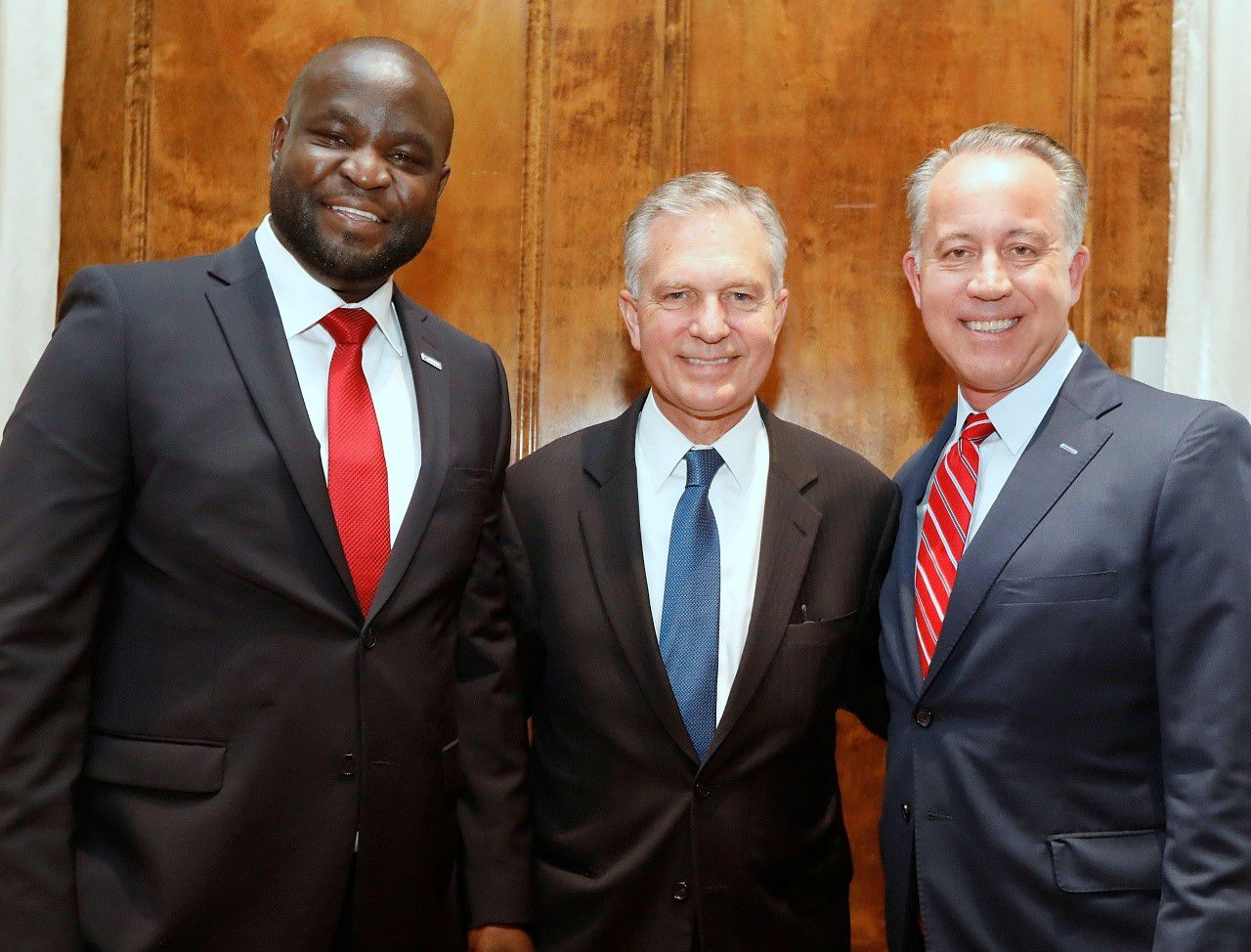 From left: John Olajide, 2020 chairman of the Dallas Regional Chamber, Dale Petroskey, chamber CEO, and Toyota executive Chris Nielsen, immediate past chamber chair, at the organization's annual meeting in January.