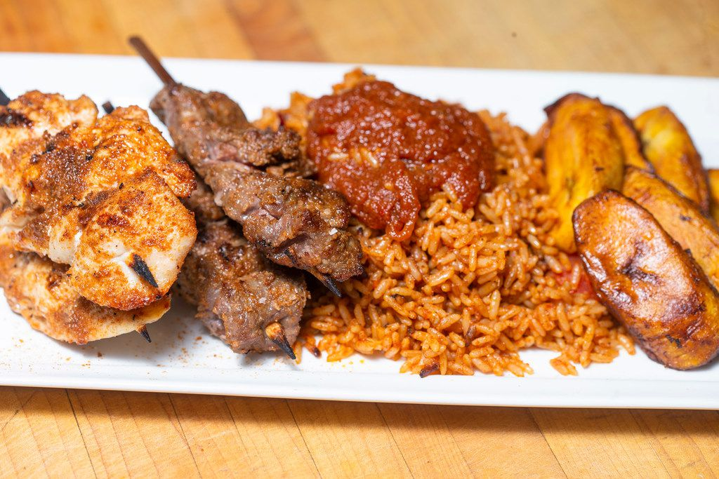Chef Kev Ashade's chicken and beef suya with fried plantains and jollof rice in his Dallas home.