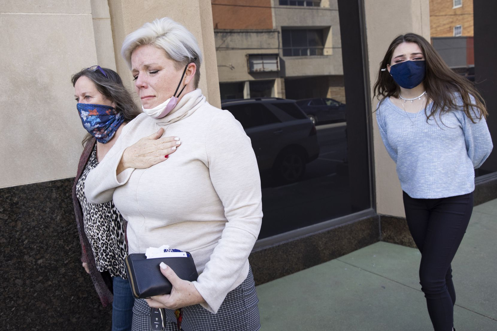Nicole Reffitt (second from left) and family walk out of the federal courthouse at the United States Courthouse Annex in Sherman after her husband's Thursday detention hearing. Guy W. Reffitt is facing charges after the riot at the U.S. Capitol on Jan. 6.