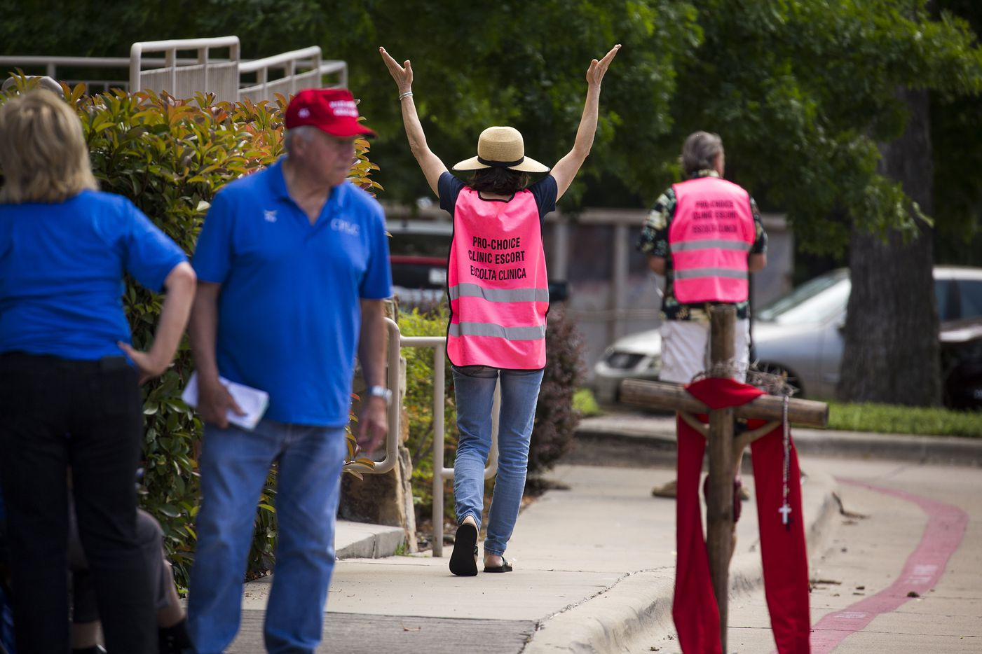 Abortion rights advocates (right) stand outside Southwestern Women's Surgery Center as abortion opponents (left)  hold an annual Good Friday vigil on Greenville Avenue outside the facility on Friday, April 14, 2017, in Dallas.