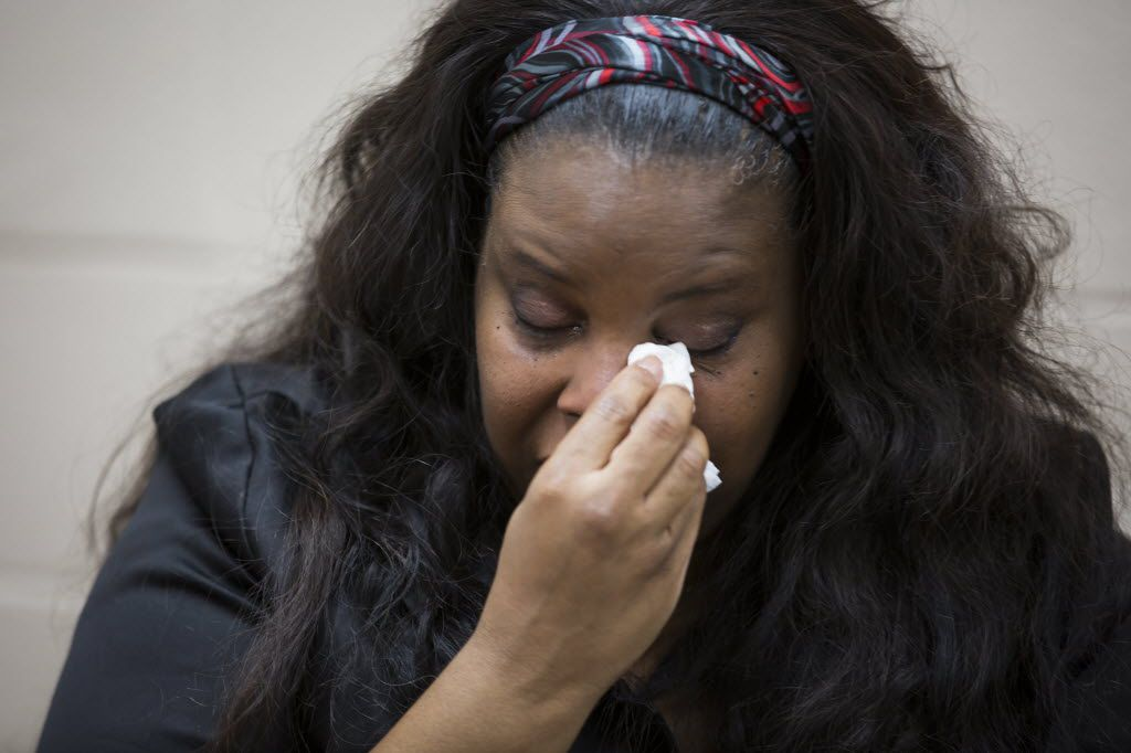 Janet Baker wipes a tear as she conducts an interview after hosting a radio show at the KCOH studios on Friday, June 24, 2016, in Houston. Baker's son Jordan was shot  by a Houston police officer in 2014, a few weeks before his 27th birthday. He was unarmed and riding his bicycle at a strip mall at the time. A grand jury declined to indict the officer.