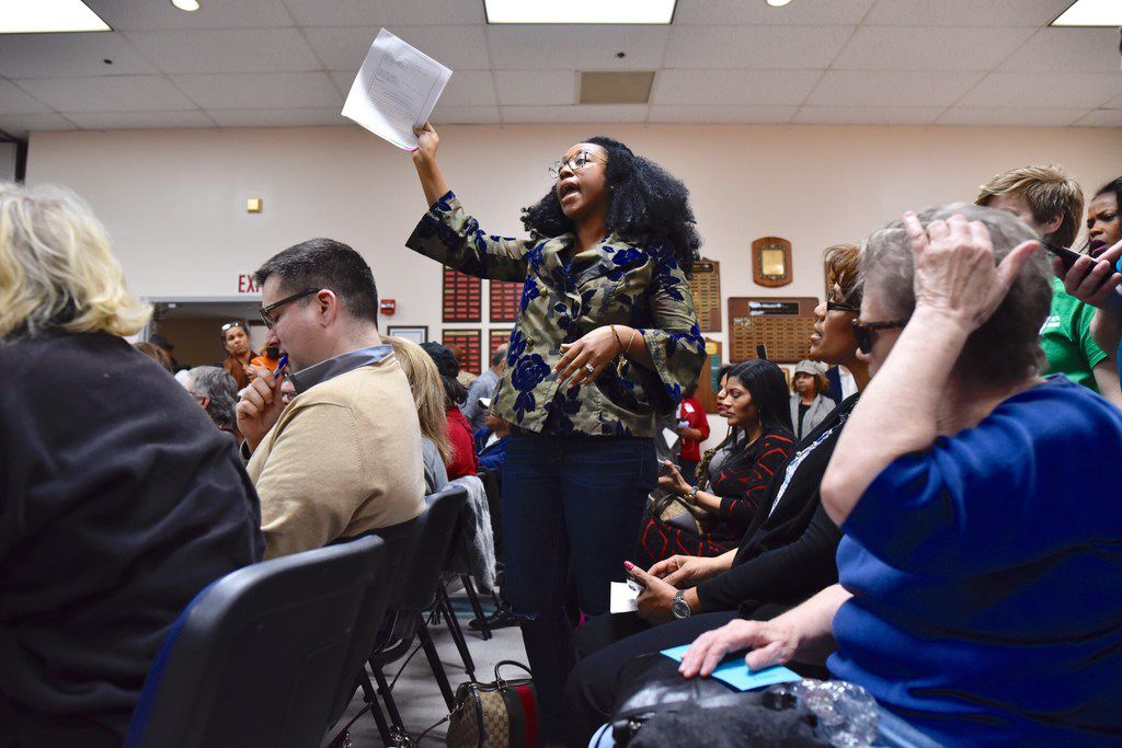 Judge Amber Givens-Davis of the 282nd Judicial District Court, whose name was among the petitions not signed by the Democratic party chair, stands to ask a question about a lawsuit placed by the Dallas Republican Party during the Dallas County Democratic Party Executive Committee Meeting at the Communications Workers of America Union Hall in Dallas, Monday, Jan. 22, 2018. Ben Torres/Special Contributor