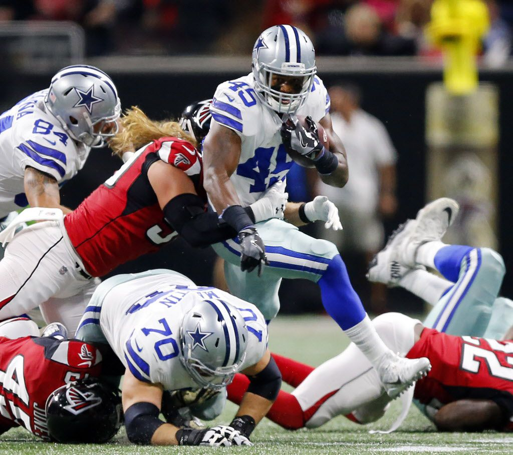Dallas Cowboys running back Alfred Morris (46) carries the ball as he tries to break the Atlanta Falcons defense in the second quarter at Mercedes-Benz Stadium in Atlanta, Georgia, Sunday, November 12, 2017. (Tom Fox/The Dallas Morning News)