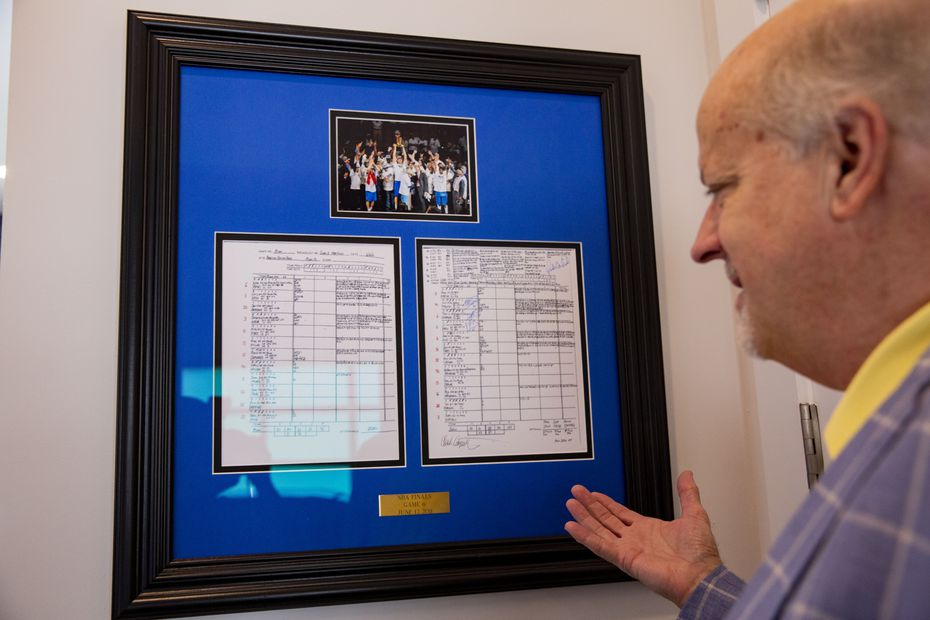 Mavericks super fan Mark Thompson, owner of Smith-Thompson security company, talks about his Chuck Cooperstein game notes from the NBA Finals Game 6  at his home on Wednesday, June 9, 2021, in Fairview.