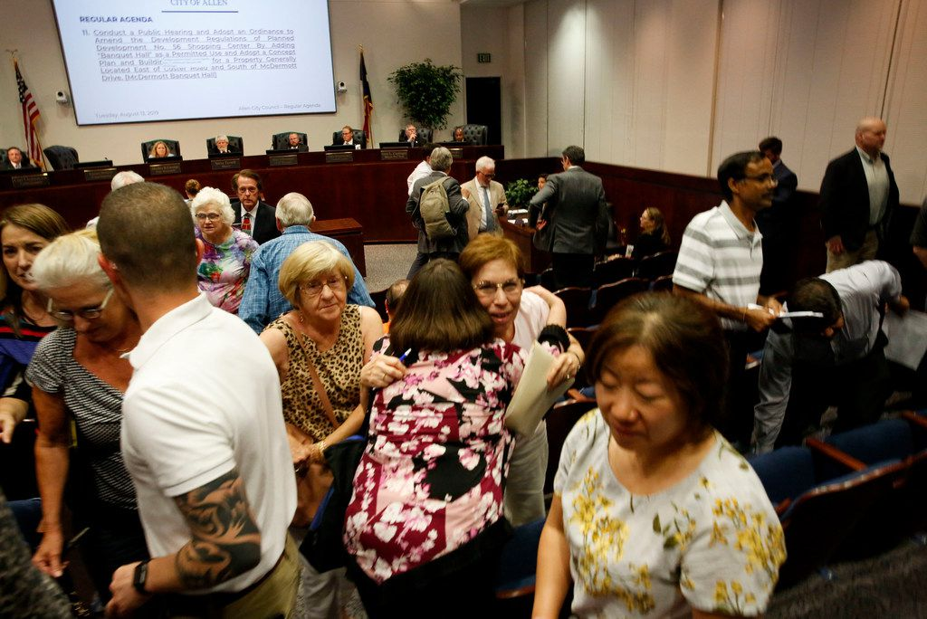 Allen resident Adelia Scaife hugs Emily Dietz just after the Allen City Council voted to deny a retail-residential development that was proposed for the Central Business District during a public hearing in Allen, Texas, Tuesday, August 13, 2019. (Brian Elledge/The Dallas Morning News)