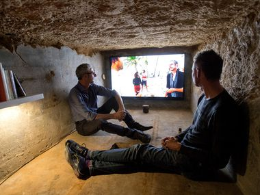 Mexico-based artist Carlos Ranc (left) discussed his work with Brandon Burrows, of Dallas, in Culture Hole. Ranc's work 'An Exhibition of Failures,' was inspired by his trip to a remote island and was featured for one night only.