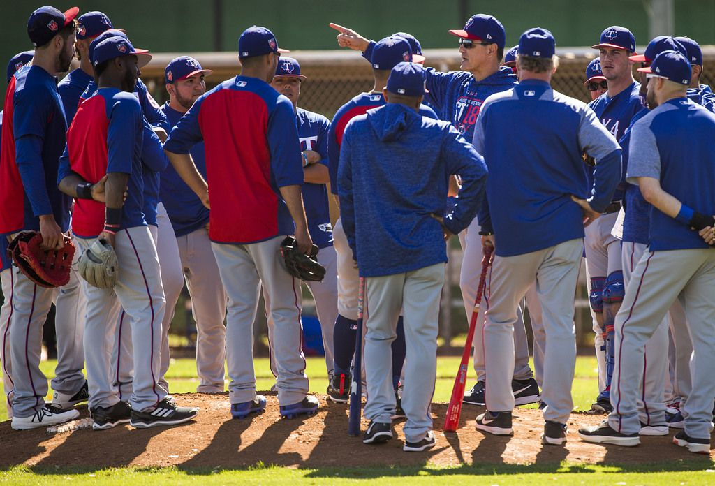 Texas Rangers players gather around bench coach Don Wakamatsu during the first full-squad spring training workout at the team's training facility on Tuesday, Feb. 20, 2018, in Surprise, Ariz. (Smiley N. Pool/The Dallas Morning News)