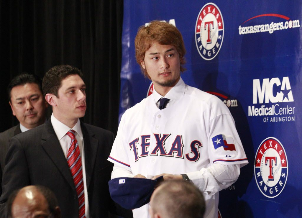 Texas Rangers manager Jon Daniels and new Texas Rangers pitcher Yu Darvish after Darvish was introduced as a Texas Ranger during  press conference at Rangers Ballpark in Arlington on Friday, January 20, 2012. (Michael Ainsworth/The Dallas Morning News)