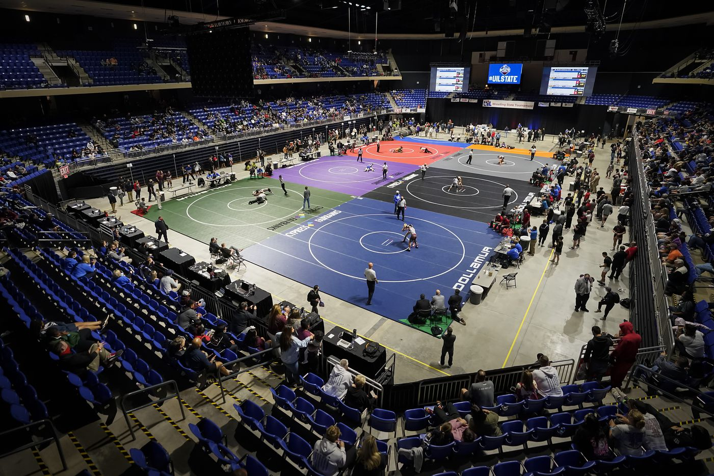 Wrestlers compete in during the UIL State Wrestling tournament at the Berry Center on Friday, April 23, 2021, in Cypress, Texas.