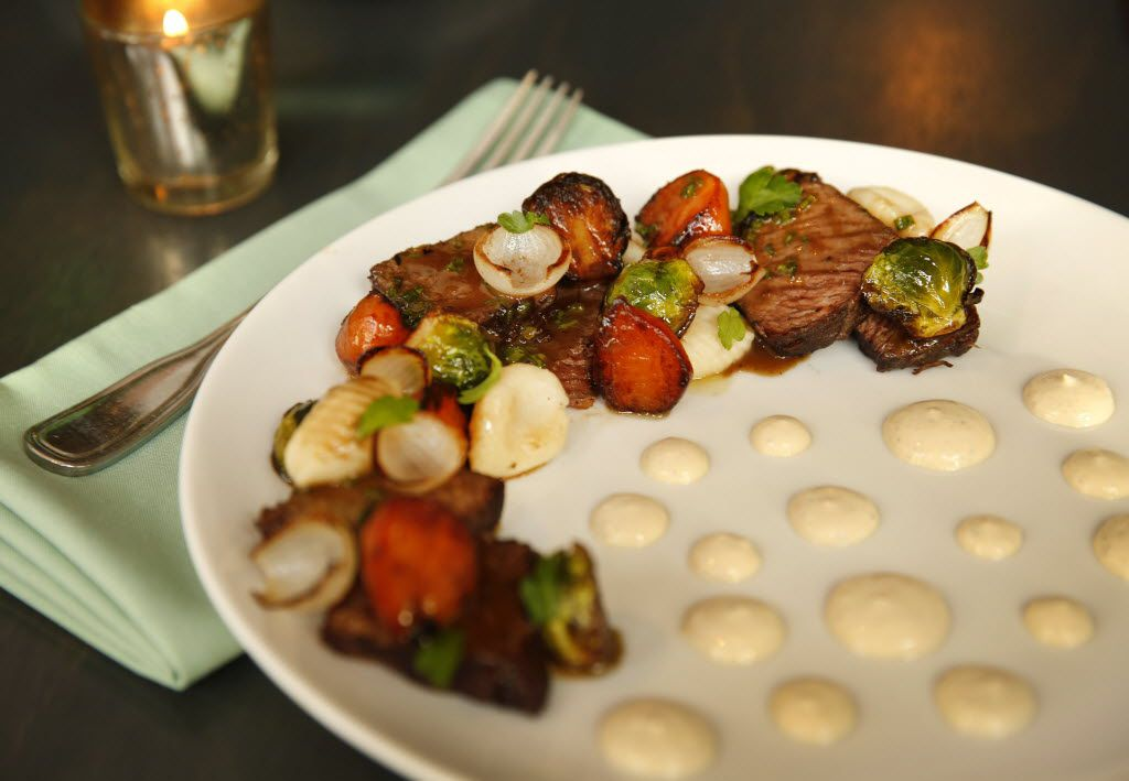 """Executive chef Danyele McPherson has unleashed her creativity at Remedy, and the results are delicious. One example: the """"hobo dinner"""" -- red wine-braised short rib with gnocchi, caramelized Brussels sprouts, Thumbelina carrots, charred pearl onion and glossy dots of horseradish cream."""