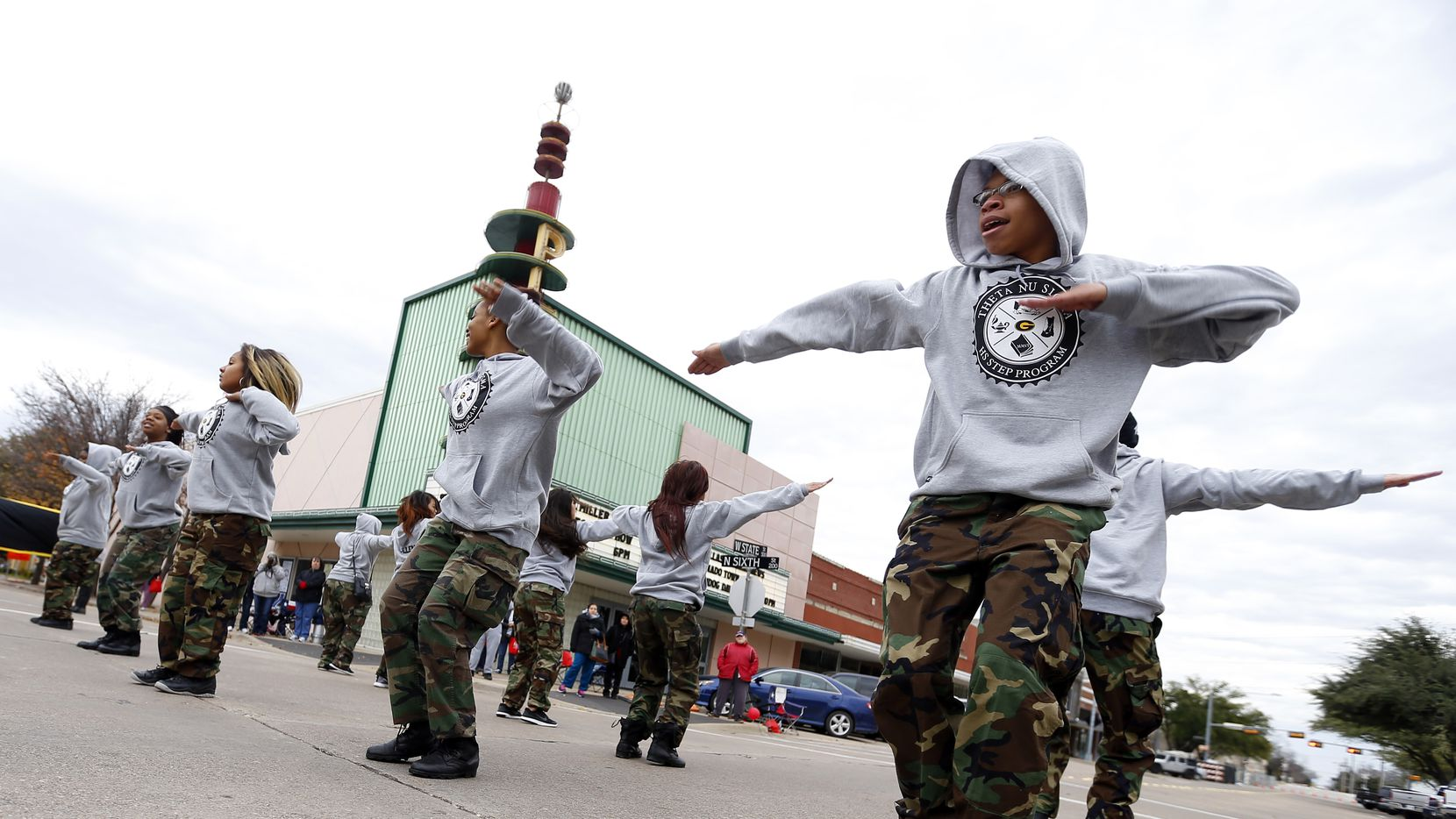 Members of the Garland High School step team, including Zavier Chatman (right) perform in the 27th Annual MLK Parade and March sponsored by the NAACP Garland Unit in downtown Garland on Saturday, January 16, 2016.